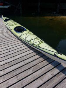 Green kayak on a dock