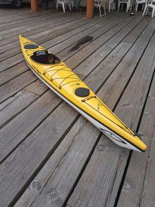 Yellow kayak on a dock