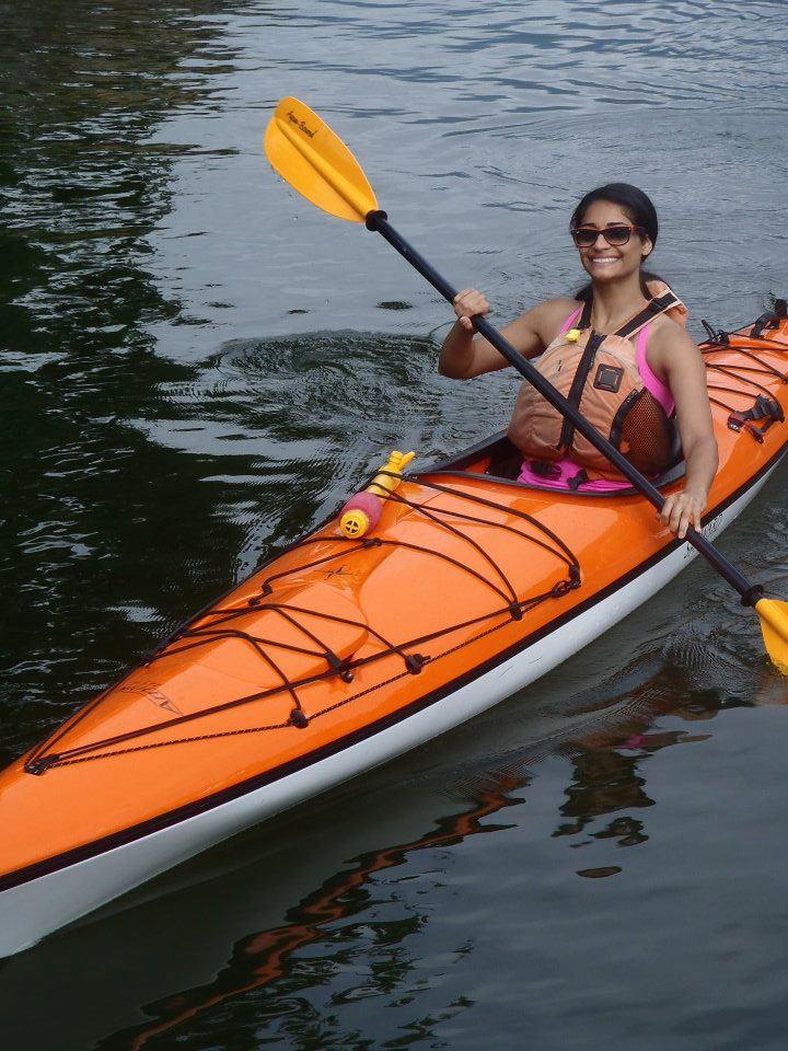 Smiling woman in an orange kayak