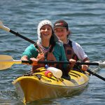 Kids in a yellow double kayak