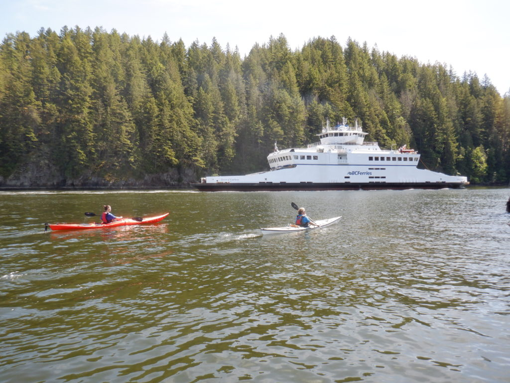 kayaking with ferry nearby