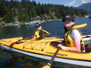 two young girls in yellow kayaks